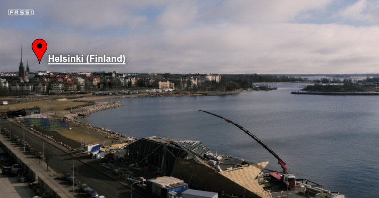 Fassi-F2150RAL-knuckle-boon-crane-in-action-on-a-building-site-near-Helsinki