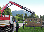 A Fassi crane to place Moroni's sign in Albino