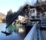 Mobile installation with Fassi loader crane for dammed lake cleaning